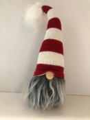 A Nisse/Tomte/Tonttu Dressed With Red and White Hat